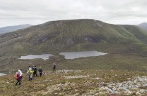 Walkers on a Hike going towards Lakes